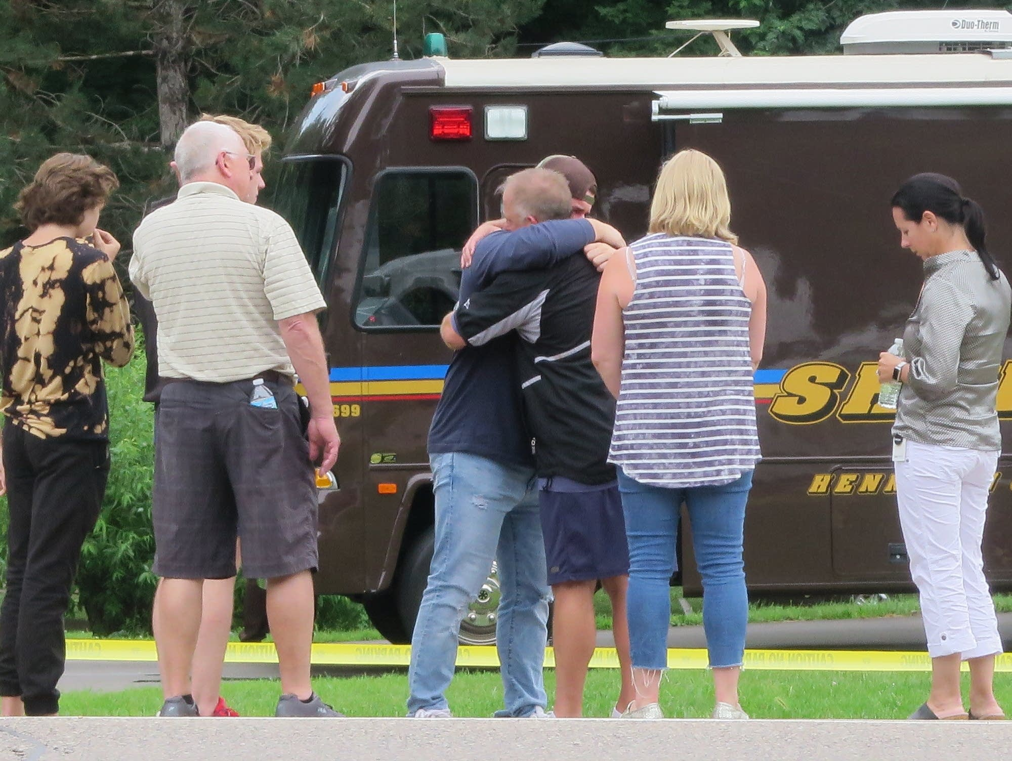 People mourn by Hwy. 7 on July 13, near where deputies shot Archer Amorosi.