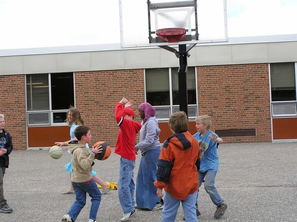 Pelican Rapids kids play with their guests
