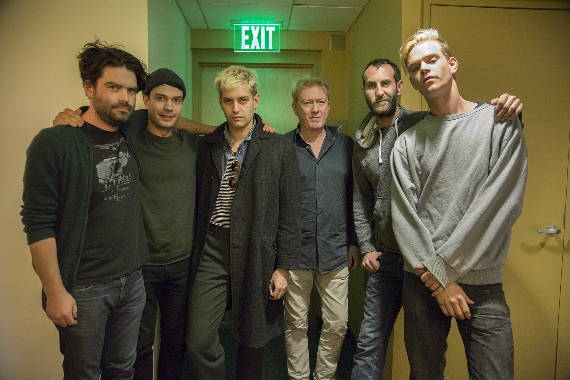 Andy Gill (center) meets Viet Cong