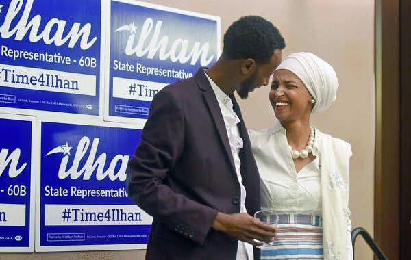 Amhed Hirsi hugs his wife.
