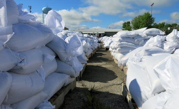 Pallets of sandbags stack up at Kerry Park.