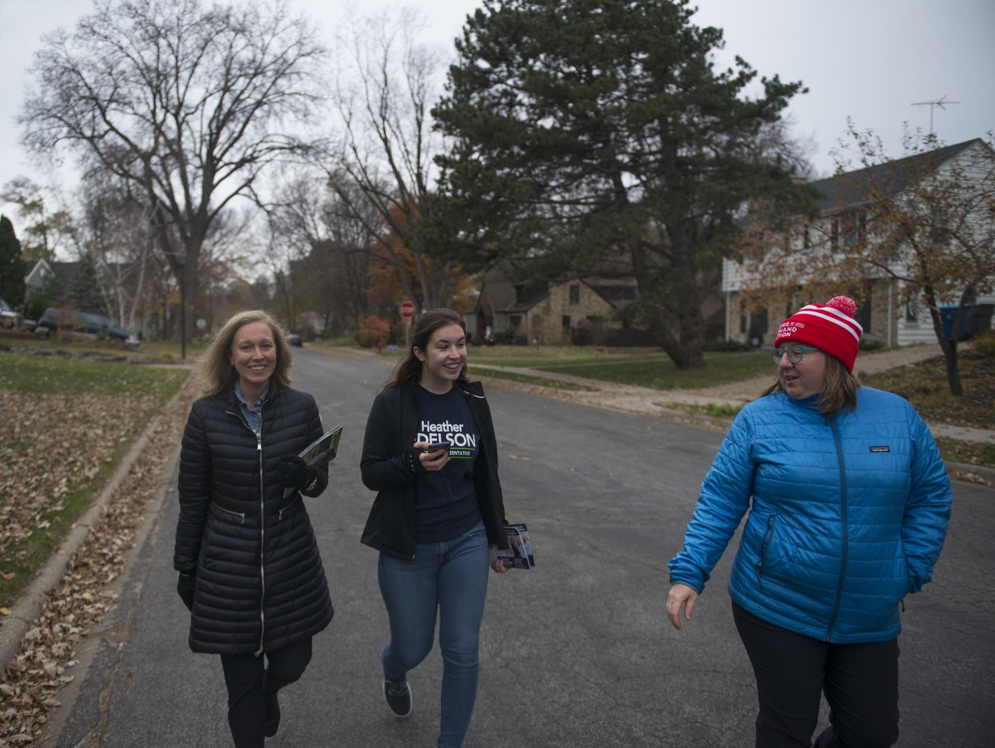 Heather Edelson walks down the street with Macy Rooney and Cathy Cozad
