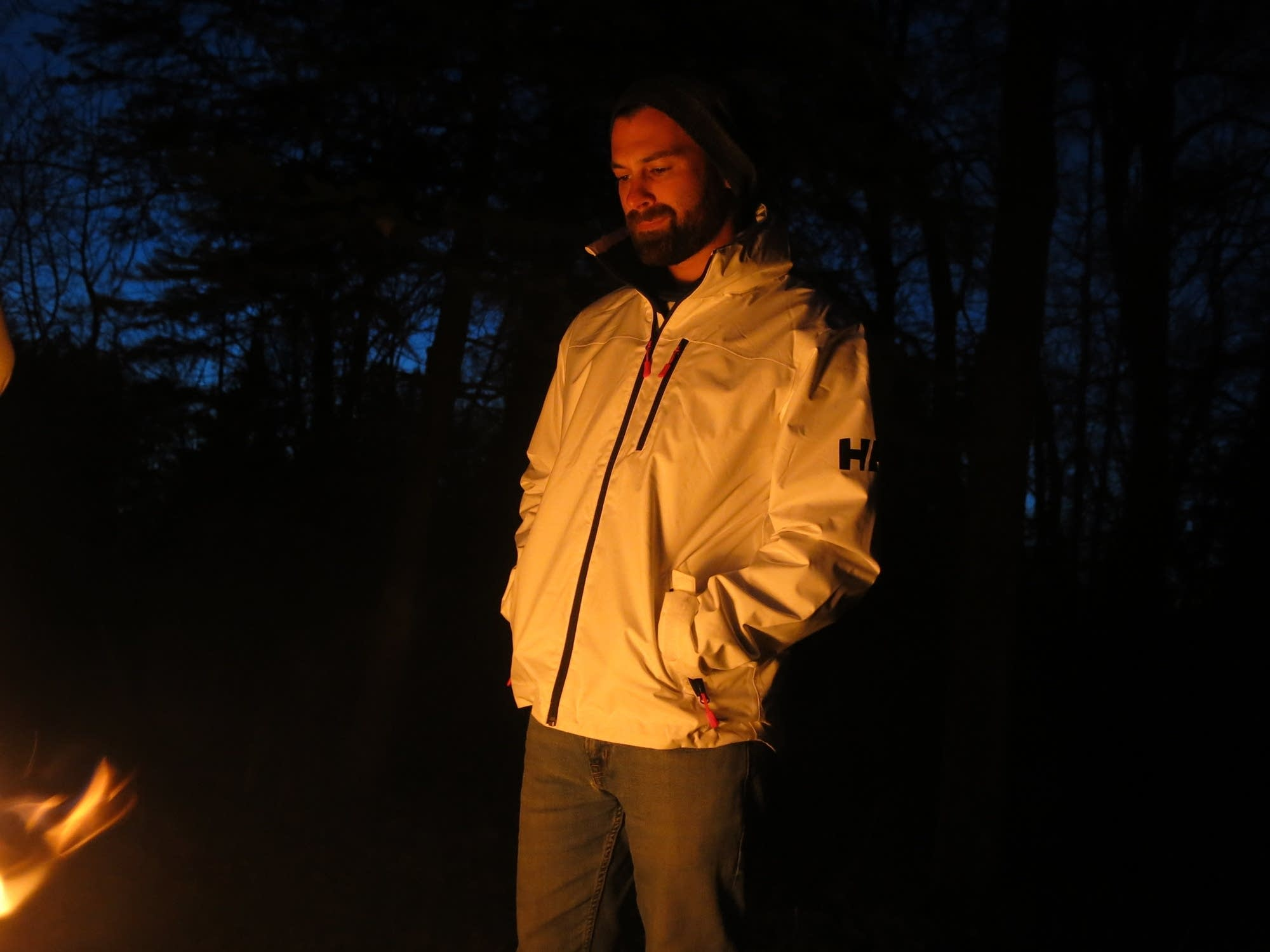 Nate Lastinger stands by the fire in Itasca State Park.