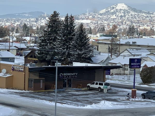 "Photo of a one-story brown building w/ ""Serenity Casino"" on the sign"