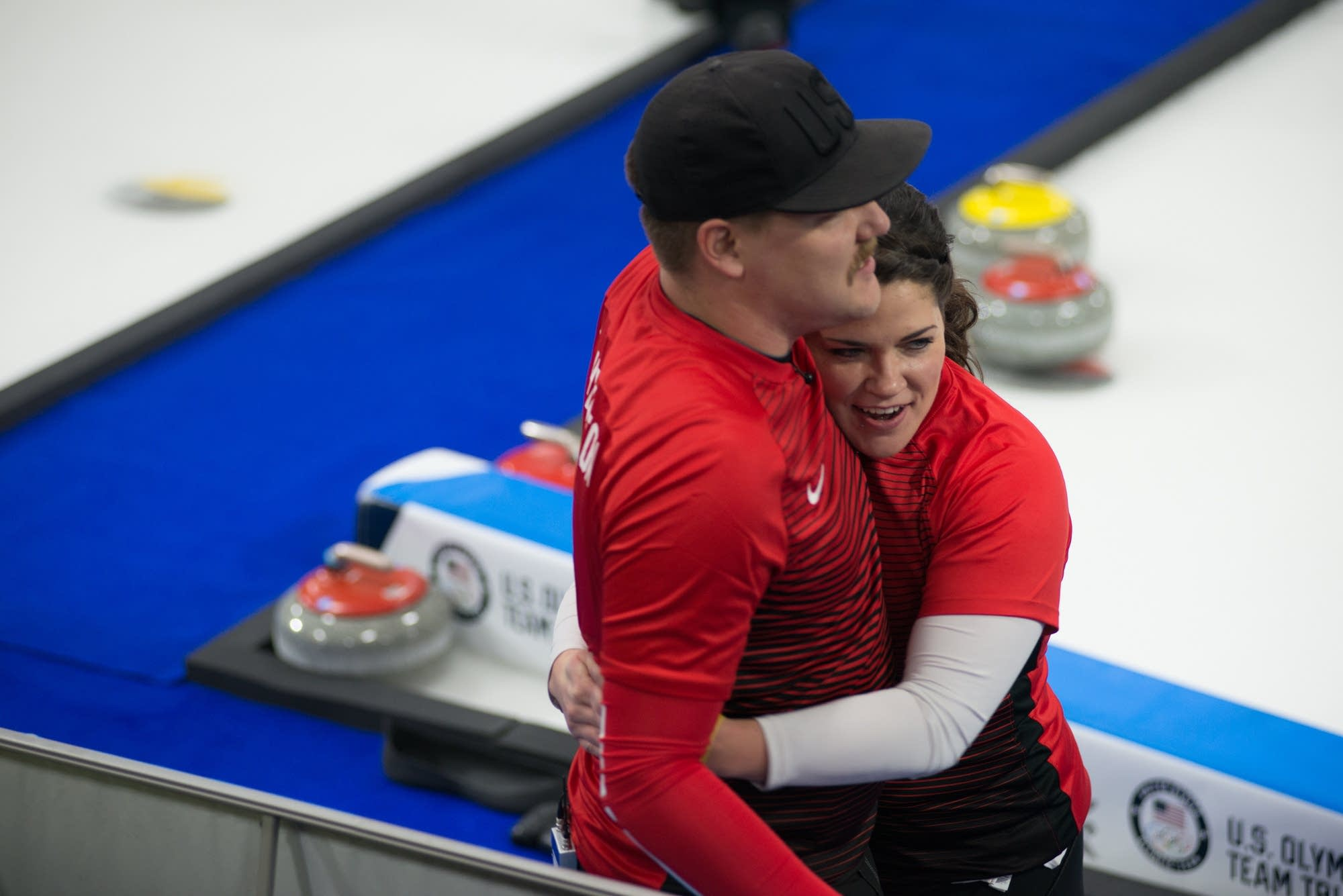 Sibling curling duo Matt and Becca Hamilton celebrate a 6-5 win.