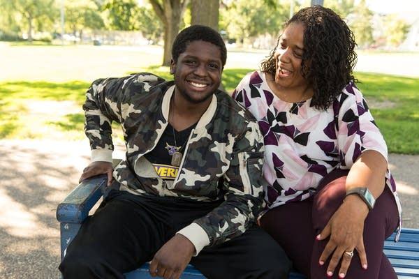 Trey, 22, and Rae Blaylark, sit for a portrait in Stewart Park.