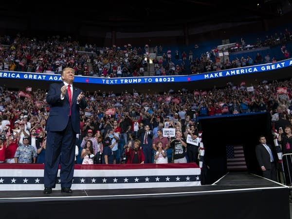 President Trump arrives on stage to speak at a campaign rally