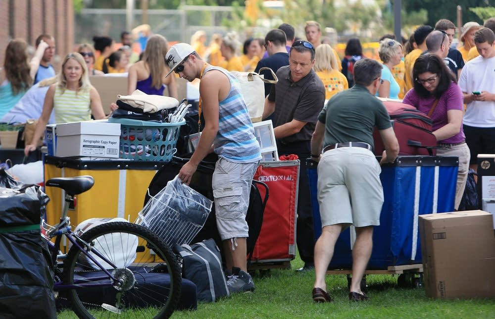 Incoming freshmen and their families pack bins.