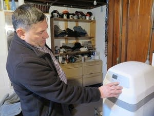 Morris City Manager Blaine Hill changes the settings on his water softener