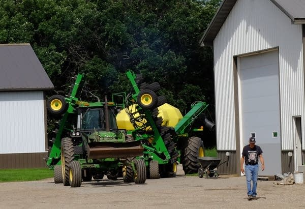 Matt and Larry Ness put spring planting equipment into storage.