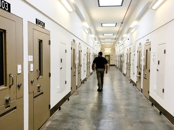 Security chief Joe Charvat walks the halls of the state penitentiary's BIU.