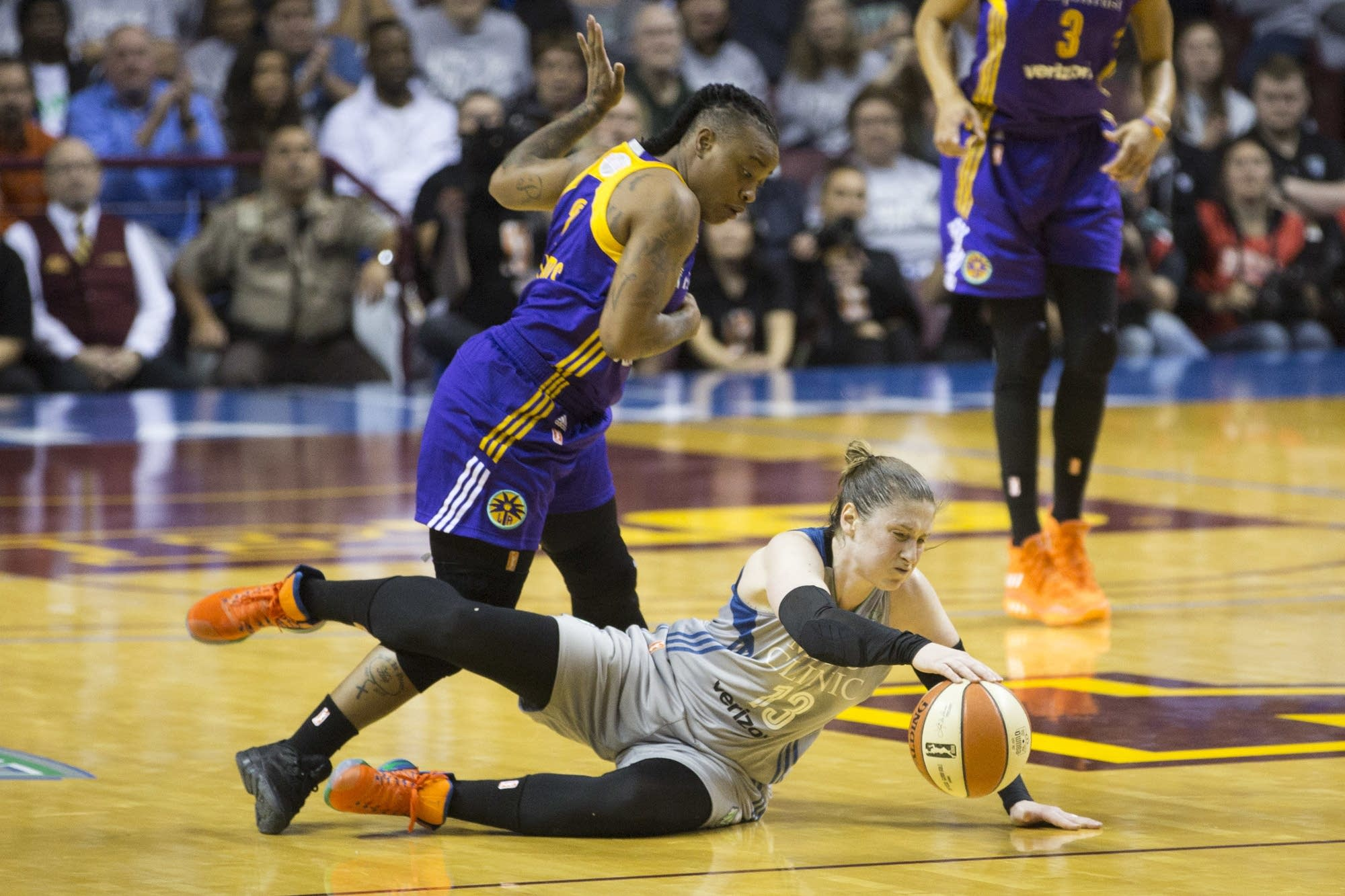 Lindsay Whalen lays out for a loose ball.