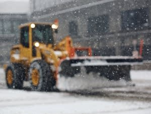 Heavy machinery plows 7th St. in St. Paul