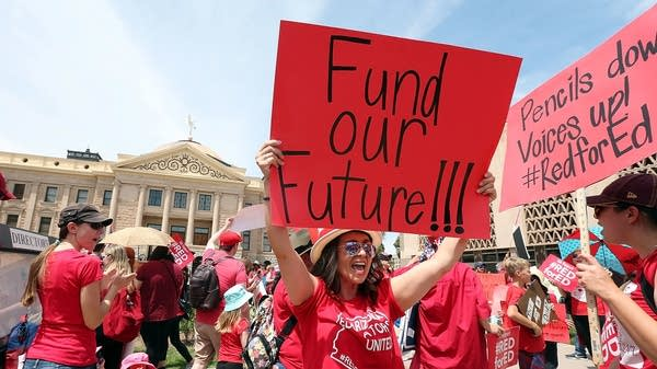 Edged out of the middle class, teachers are walking out