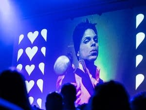 Images of Prince appear on a screen at First Avenue.