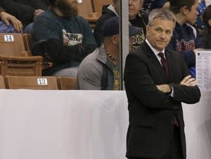 Minnesota head coach Don Lucia looks on from the bench