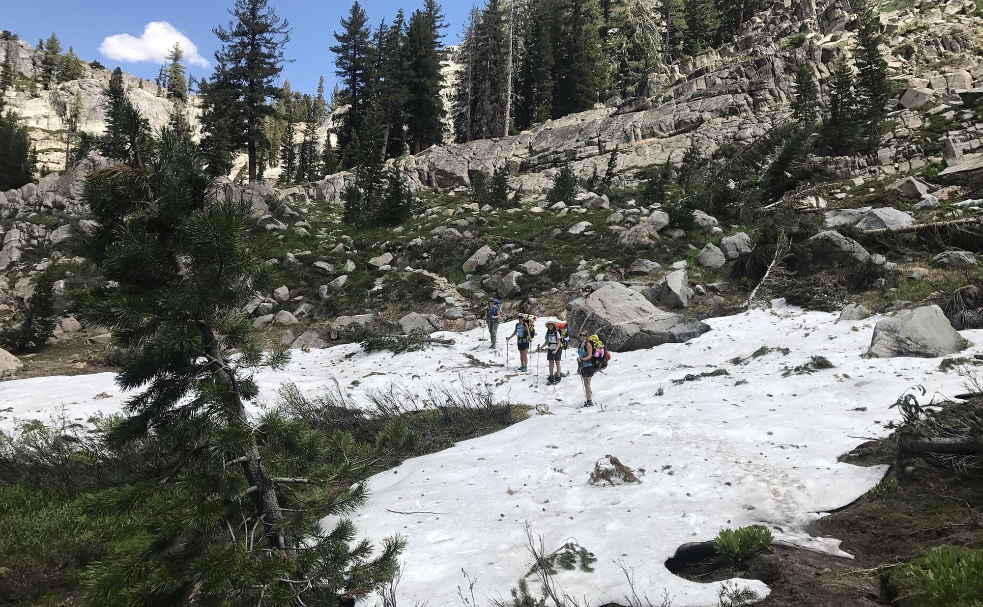 The hiking group traversed snow