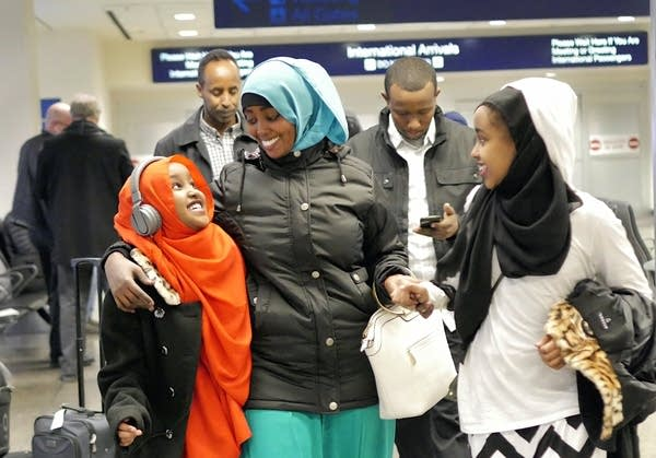 Asiya Iyow and her sister Maryama welcome their aunt, Ayan Abdi.