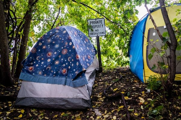 Two tents sat in the woods on top of a hill in St. Paul, Minn.