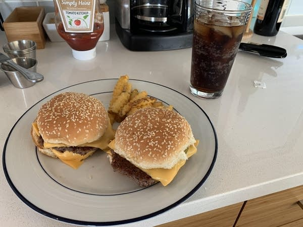 A picture of 2 homemade McDonald's-style hamburgers that Luke made
