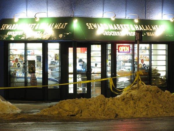 Investigators at scene of triple slaying