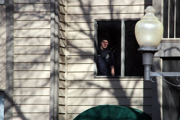 A police officer looked out the window Sunday.