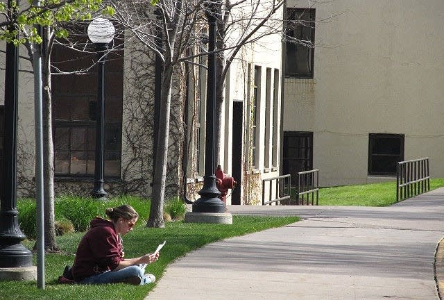 Student reads outside the ag school