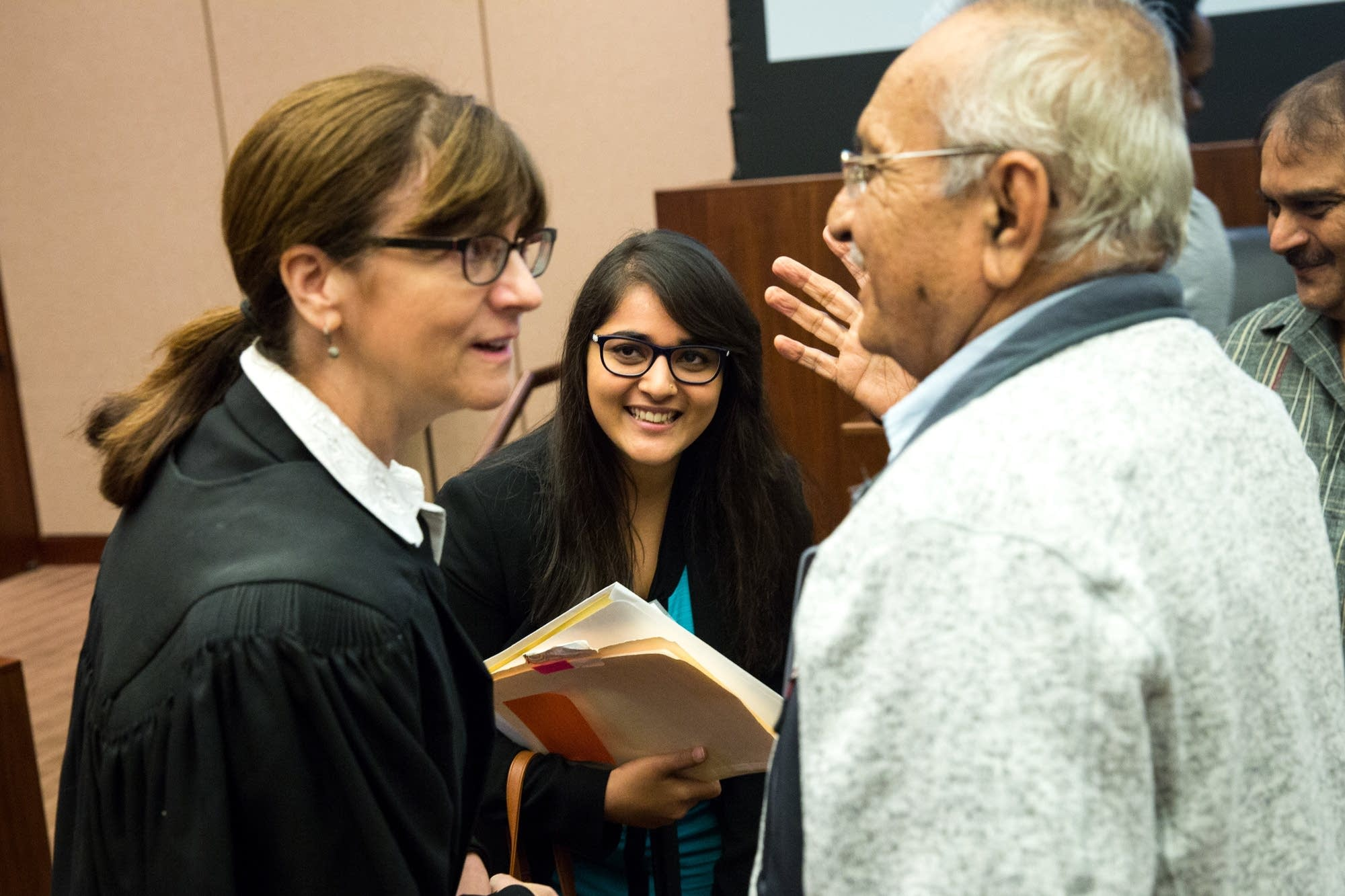 Judge Becky Thorson socializes after the ceremony.