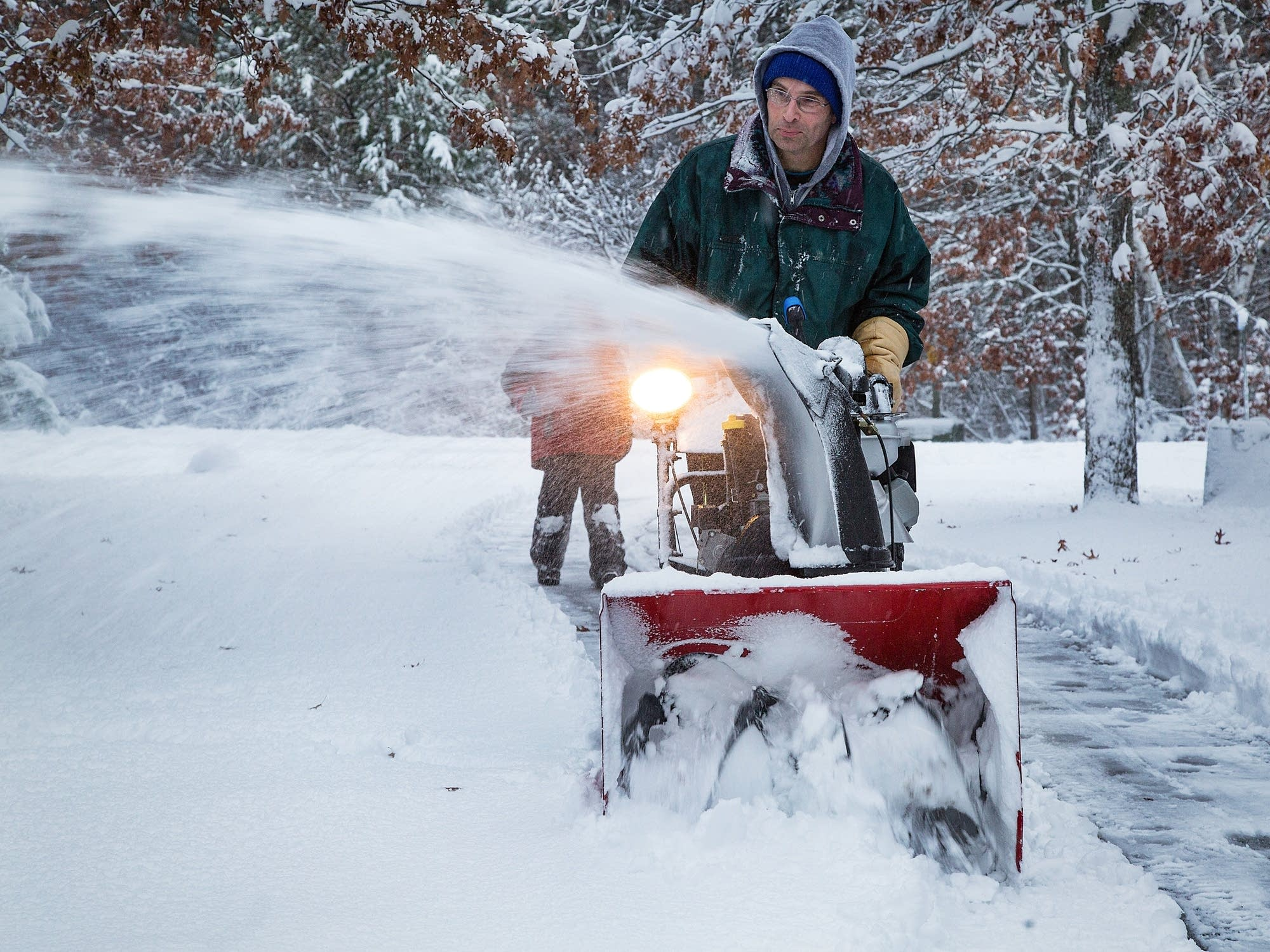 Dave Mause clears several driveways in his neighborhood.