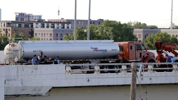 Authorities stand near a tanker truck