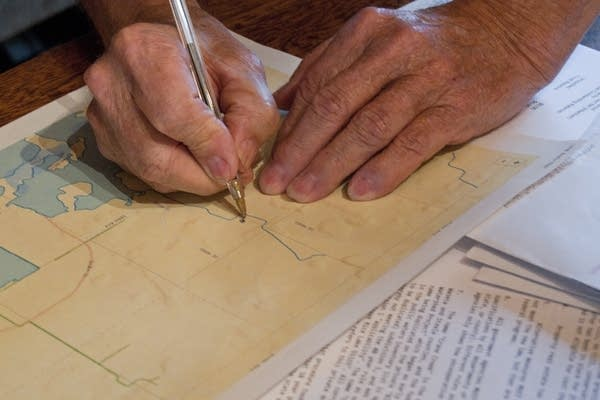 Rollie Norton marks his property on a map