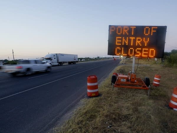 A sign announces a border crossing is closed