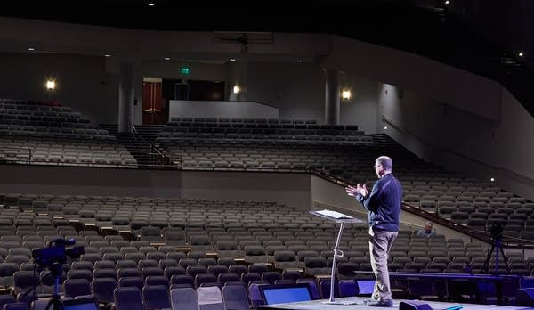 Troy Dobbs speaks to empty pews.