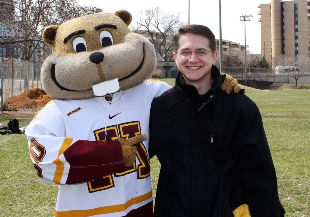 Law student Kyle Kroll and Goldy Gopher