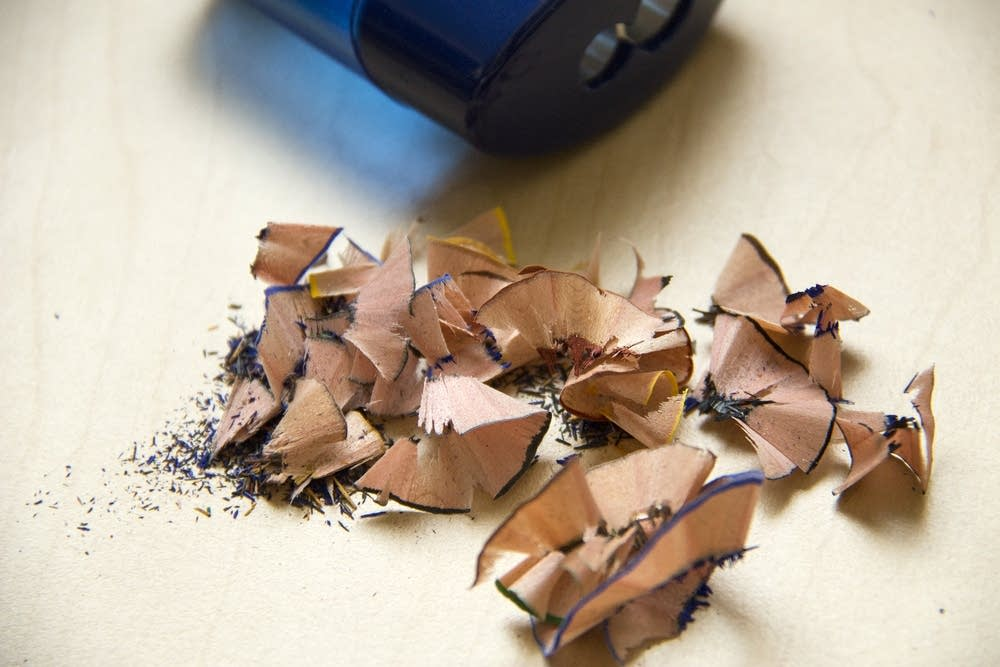 A pencil sharpener and shavings.