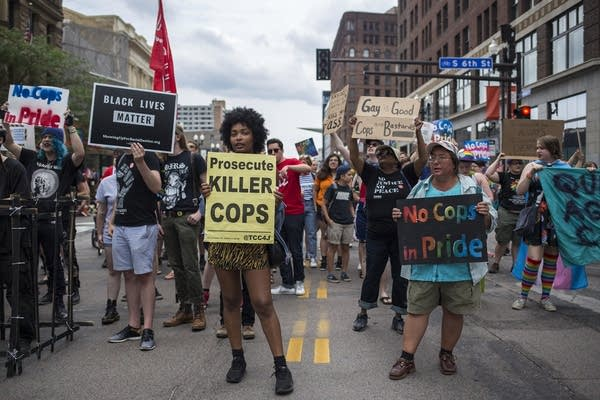 A group of protestors occupied Hennepin Avenue during Pride parade.
