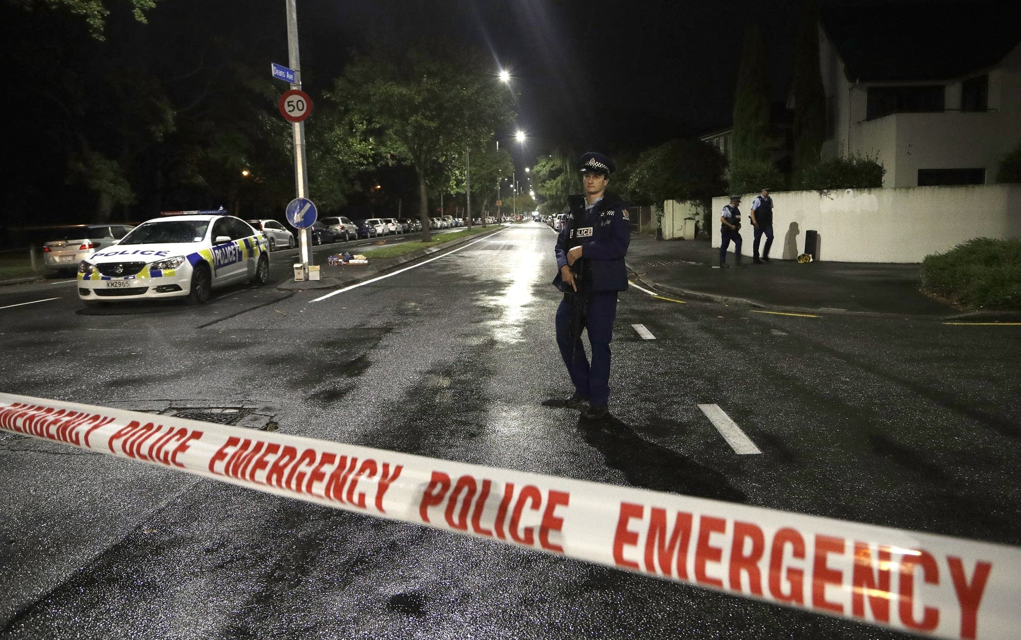 An officer patrols at a cordon near a mosque in central Christchurch.