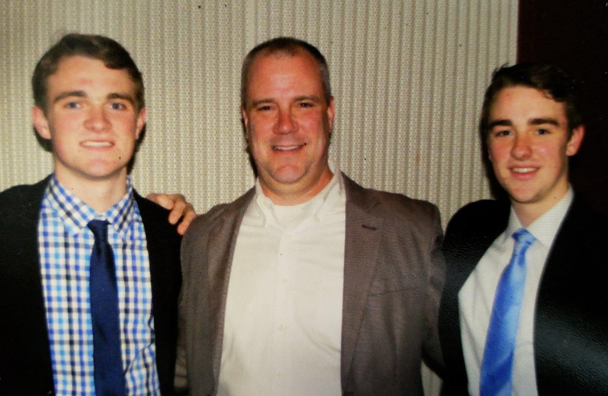 Robert, Ray, Sr., and Ray Christy, Jr., at the MSHSL hockey banquet, 2017.