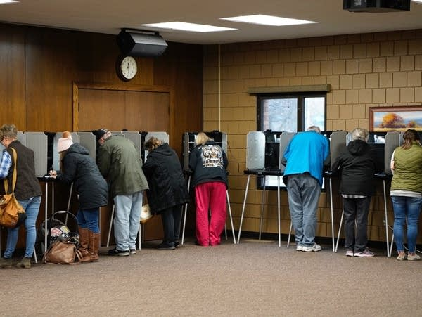 People fill voting booths at Our Saviour's Evangelical Lutheran Church.