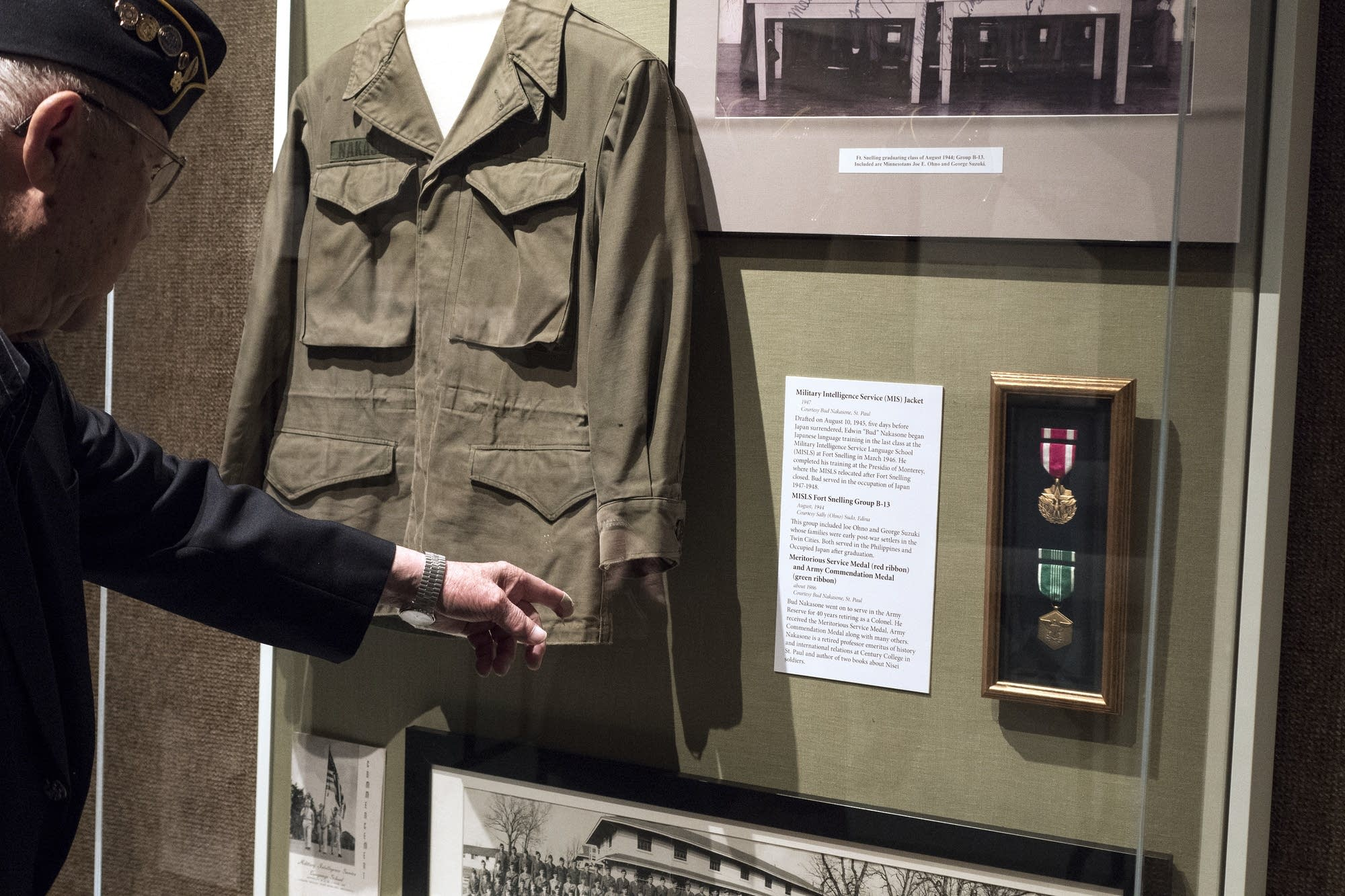 Bud Nakasone of St. Paul points out his jacket and medals in the display.