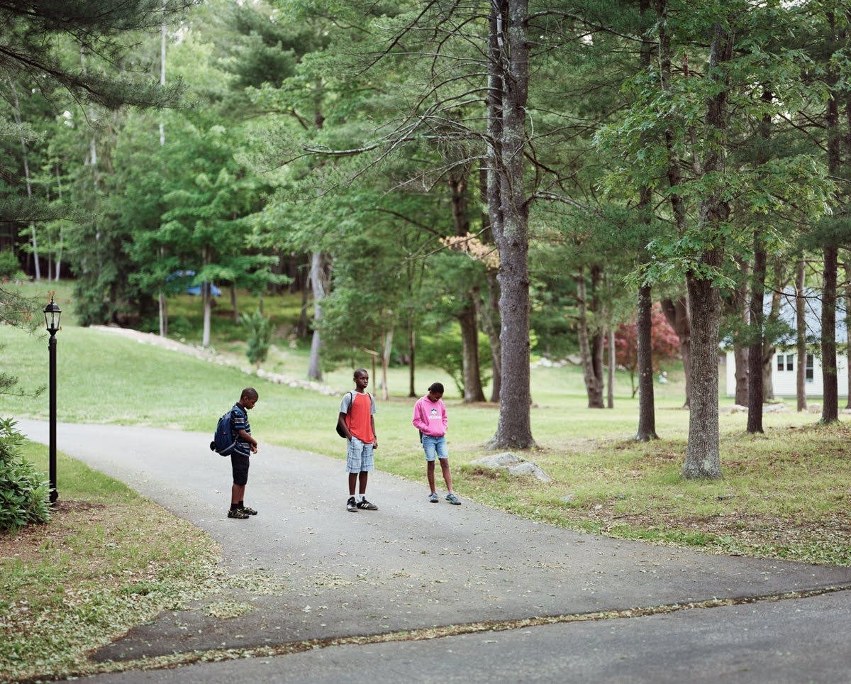 Children wait for their morning bus to school.