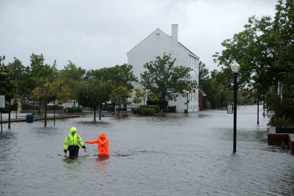 Residents walk in flooded streets in New Bern, N.C.