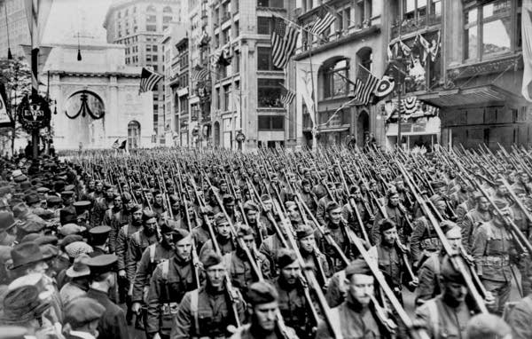 Soldiers of the US Army 308th Infantry march up New York's Fifth Avenue