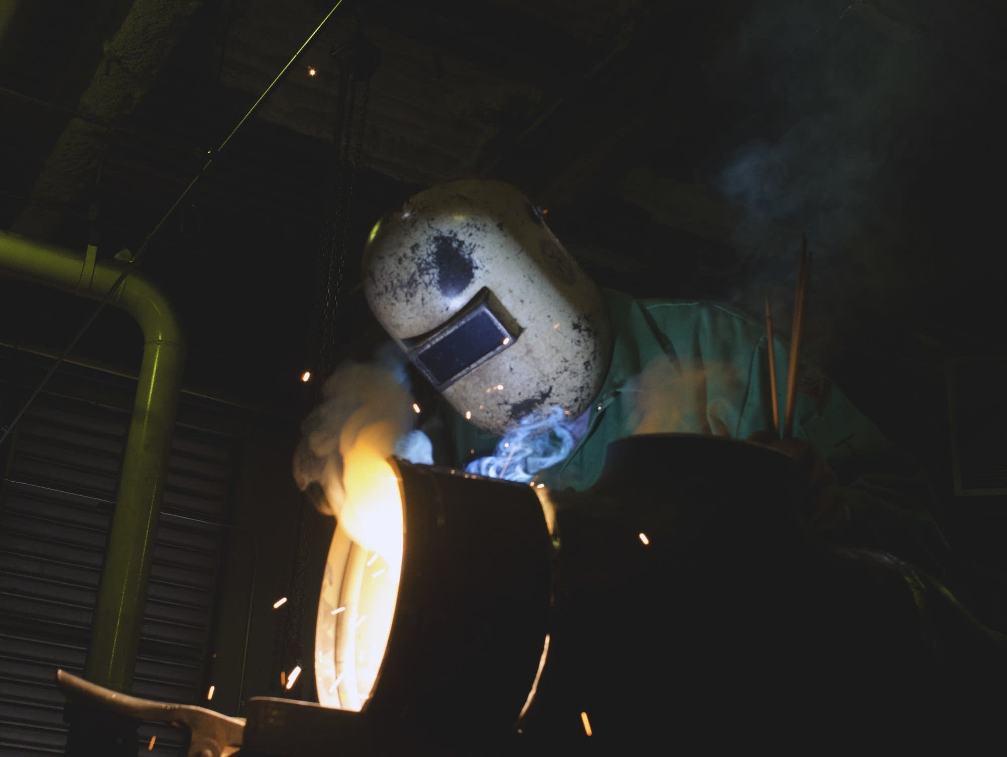 Jay Larson welds in the U.S. Bank boiler room.