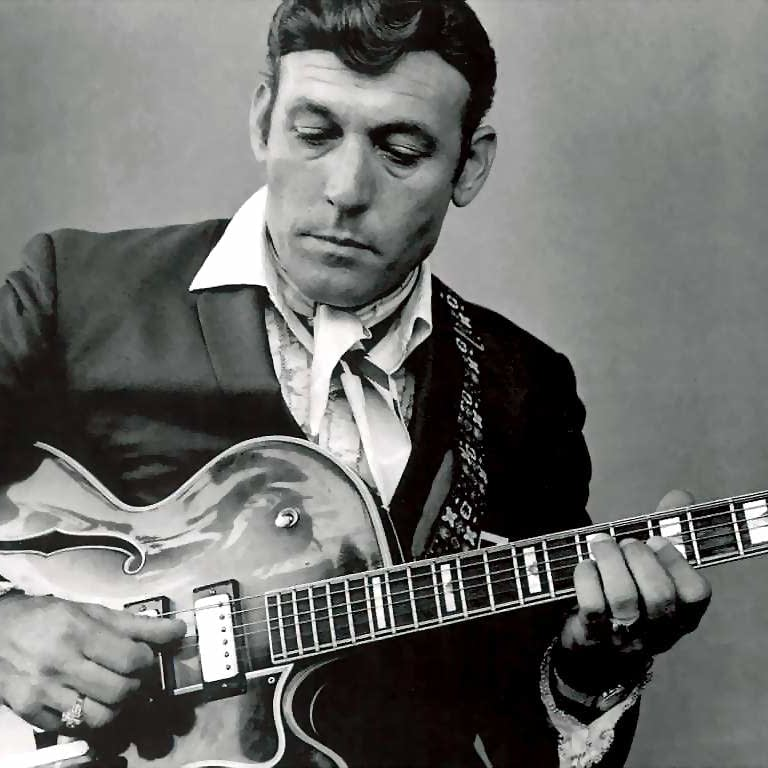 Carl Perkins with a guitar
