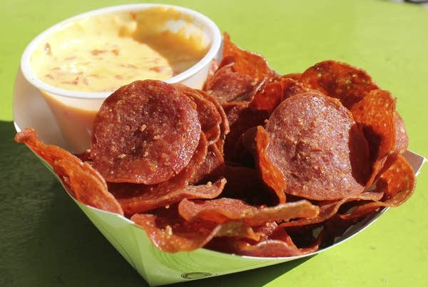 Pepperoni chips with roasted red pepper queso