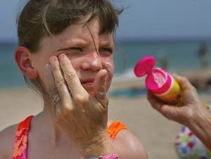 Putting on sunscreen