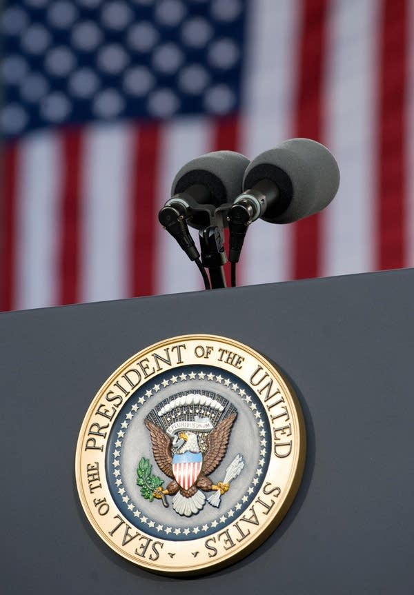 The presidential podium with the officia