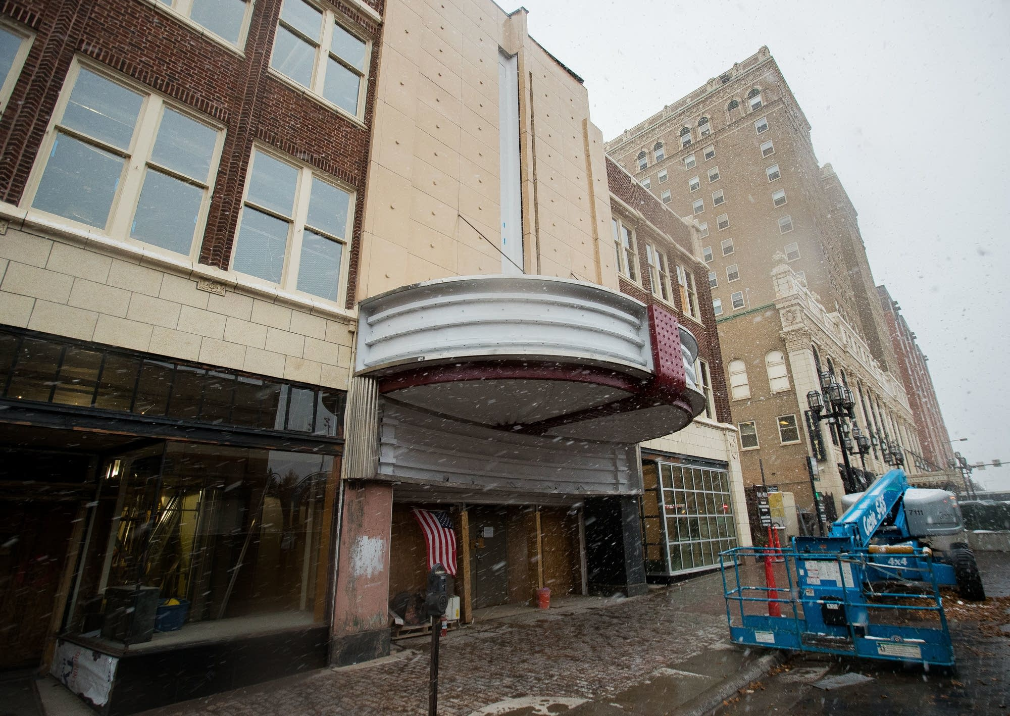 Snow falls outside as work continues on the NorShor Theater Nov. 1, 2017.