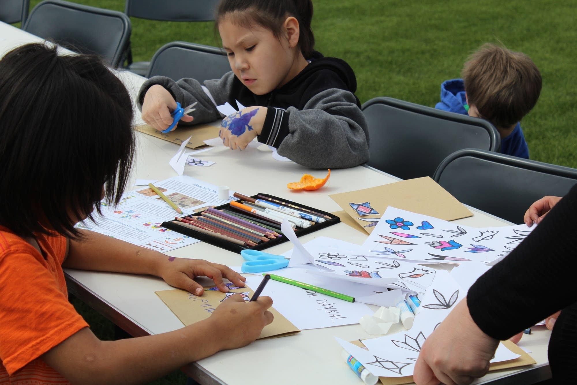 Kids practice a Dakota language exercise at Fort Snelling.